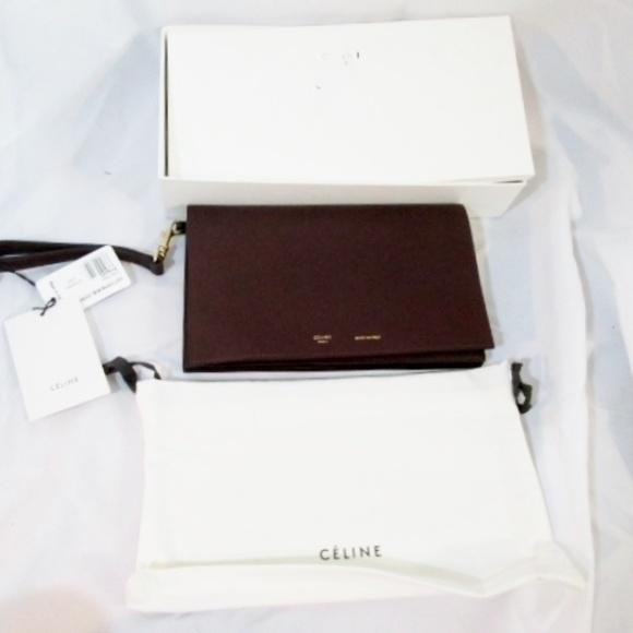 Celine Handbags - NEW CELINE PARIS STRAP CLUTCH BURGUNDY Wristlet